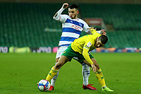 29th December 2020; Carrow Road, Norwich, Norfolk, England, English Football League Championship Football, Norwich versus Queens Park Rangers; Ilias Chair of Queens Park Rangers challenges Emi Buendia of Norwich City