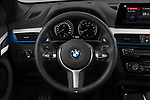 Car pictures of steering wheel view of a 2020 BMW X1 M-Sport 5 Door SUV Steering Wheel