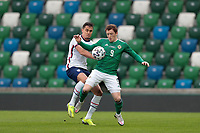 BELFAST, NORTHERN IRELAND - MARCH 28: Aaron Long #3 of the United States and Shane Lavery #9 of Northern Ireland during a game between Northern Ireland and USMNT at Windsor Park on March 28, 2021 in Belfast, Northern Ireland.