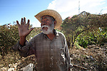 An elderly Mexican garbage collector gestures as he works in a dump in Oaxaca city, in southern state of Oaxaca, December 4, 2006. Photo by Heriberto Rodriguez