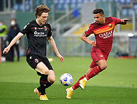 Football, Serie A: AS Roma - Bologna, Olympic stadium, Rome, April 11, 2021. <br /> Roma's Bruno Peres (r) in action with Bologna's Andreas Skov Olsen (l) during the Italian Serie A football match between AS Roma and Bologna at Rome's Olympic stadium, Rome, on April 11, 2021.  <br /> UPDATE IMAGES PRESS/Isabella Bonotto