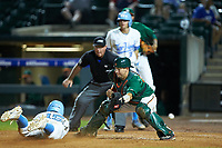 Miami Hurricanes catcher Joe Gomez (40) can't handle the throw as Michael Busch (15) of the North Carolina Tar Heels slides into home plate during the second semifinal of the 2017 ACC Baseball Championship at Louisville Slugger Field on May 27, 2017 in Louisville, Kentucky. The Tar Heels defeated the Hurricanes 12-4. (Brian Westerholt/Four Seam Images)