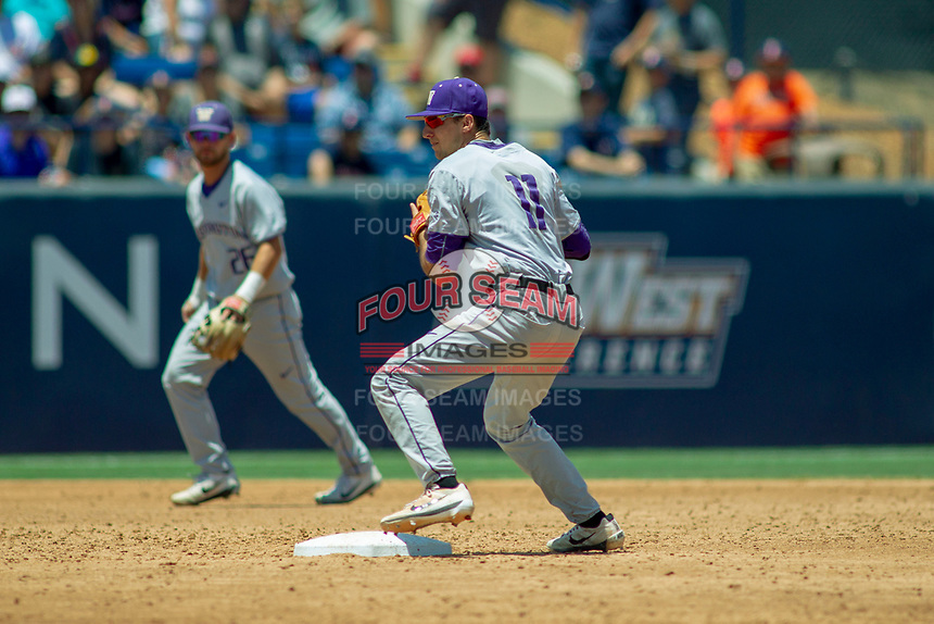 University of Washington Huskies AJ Graffanino (11) makes a throw to first base against the Cal State Fullerton Titans at Goodwin Field on June 08, 2018 in Fullerton, California. The University of Washington Huskies defeated the Cal State Fullerton Titans 8-5. (Donn Parris/Four Seam Images)
