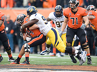 Ernest Owusu of California sacks Oregon State quarterback Cody Vaz during the game at Reser Stadium in Corvallis, Oregon on October 30th, 2010.   Oregon State defeated California, 35-7.