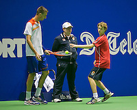 21-12-13,Netherlands, Rotterdam,  Topsportcentrum, Tennis Masters, Thomas Schoorel (NED) receives a ball from a ballboy<br /> Photo: Henk Koster
