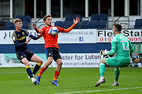 17th October 2020; Kenilworth Road, Luton, Bedfordshire, England; English Football League Championship Football, Luton Town versus Stoke City; Luke Berry of Luton Town chests the ball back to keeper Simon Sluga