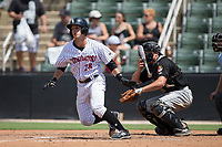 Grant Massey (28) of the Kannapolis Intimidators follows through on his swing against the West Virginia Power at Kannapolis Intimidators Stadium on June 18, 2017 in Kannapolis, North Carolina.  The Intimidators defeated the Power 5-3 to win the South Atlantic League Northern Division first half title.  It is the first trip to the playoffs for the Intimidators since 2009.  (Brian Westerholt/Four Seam Images)