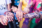 Mumbai, India. girls with their hands decorated with multicoloured henna designs to celebrate a wedding.