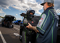 Jun 9, 2017; Englishtown , NJ, USA; NHRA funny car driver Alexis DeJoria (left) with husband Jesse James during qualifying for the Summernationals at Old Bridge Township Raceway Park. Mandatory Credit: Mark J. Rebilas-USA TODAY Sports