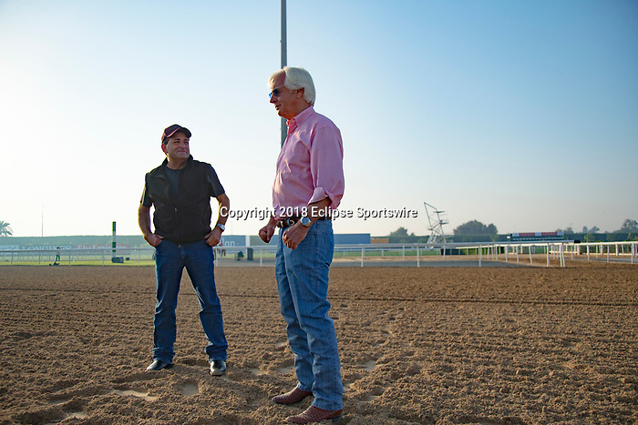 DUBAI,UNITED ARAB EMIRATES-MARCH 29: Bob Baffert (trains Mubtaahij and West Coast,right) and Jimmy Barns (assistant trainer,left),on the dirt track at Meydan Racecourse on March 29,2018 in Dubai,United Arab Emirates (Photo by Kaz Ishida/Eclipse Sportswire/Getty Images)