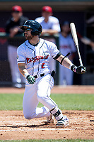 Lansing Lugnuts second baseman Ryan Gridley (2) follows through on his swing on May 30, 2021 against the Great Lakes Loons at Jackson Field in Lansing, Michigan. (Andrew Woolley/Four Seam Images)