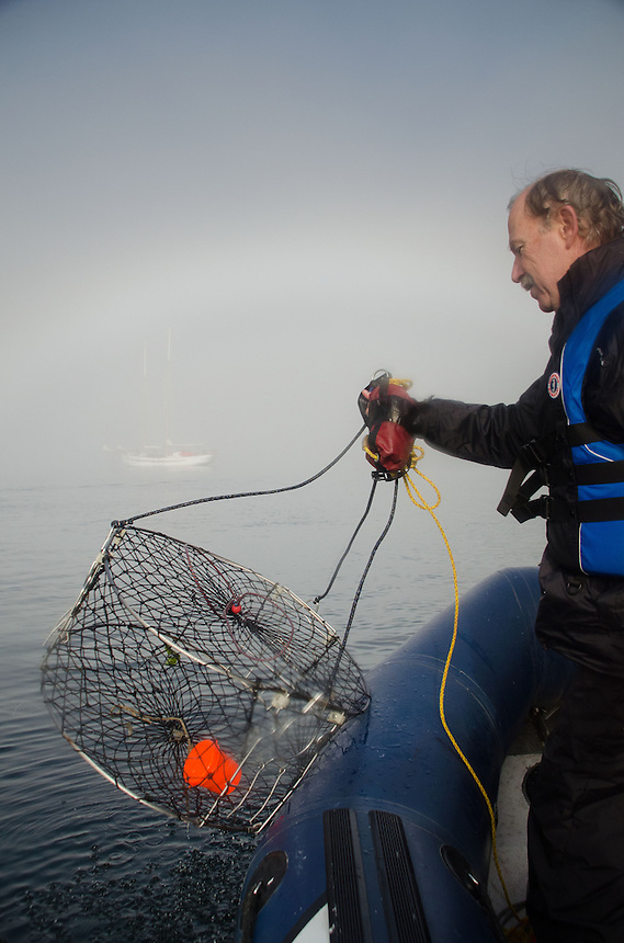 Dave Pulls In Empty Crab Pot, Gulf Islands National Park Preserve, British Columbia, Canada