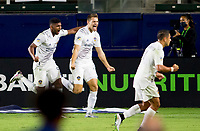 CARSON, CA - OCTOBER 18: Kai Koreniuk #28 of the Los Angeles Galaxy scores his goal and celebrates with team mate Carlos Harvey #67 during a game between Vancouver Whitecaps and Los Angeles Galaxy at Dignity Heath Sports Park on October 18, 2020 in Carson, California.