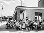Kadlub Dolny 26.07.2019 Poland<br /> Indulgence in the town of Kadłub Wolny. The residents kneel during a field mass. Kadlub Wolny, Opolskie County. This is a very special community - 400 years ago this village during the times of deep feudalism bought itself out of serfdom and for last 400 years the inhabitants have kept their independence. They established three communities: the Tavern Community, the Forest Community and the Lakes Community (now the only thing that is left are the forest, nobody has an individual part but only a share in the whole forest). The residents are very close to each other. In the picture the celebrate an indulgence and dance. <br /> Photo: Adam Lach