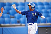 GCL Blue Jays Yorman Rodriguez (77) high fives teammates after hitting a home run during the first game of a doubleheader against the GCL Phillies on August 15, 2016 at Florida Auto Exchange Stadium in Dunedin, Florida.  GCL Phillies defeated the GCL Blue Jays 7-5 in a continuation of a game originally started on July 30th.  (Mike Janes/Four Seam Images)
