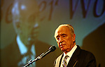 Knesset Member Shimon Peres speaks at a conference in Jerusalem Sunday Jan 08 2005. Following criticism for not clearly stating his political intentions, MK Shimon Peres on Sunday morning voiced support for the first time for Acting Prime Minister Ehud Olmert, saying that he would offer him all the help that he needed. Photo by Eyal Warshavsky