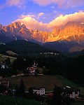 Italy, South Tyrol, Alto Adige, Dolomites, San Cipriano and Cima Catinaccio mountain range in Alpenglow