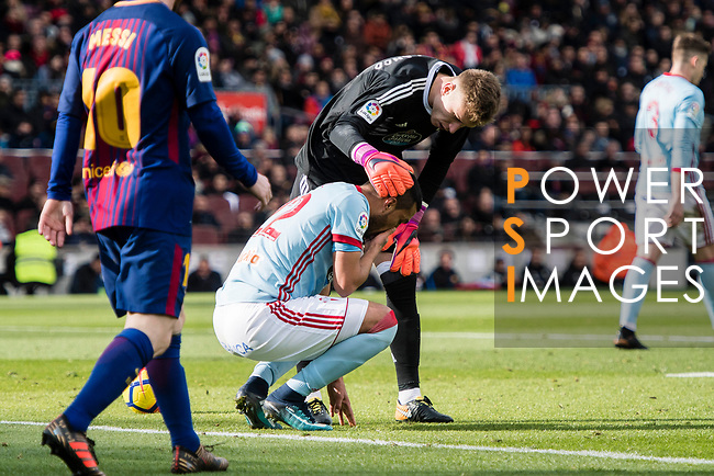 Gustavo Daniel Cabral of RC Celta de Vigo (L) is assisted by his teammate Goalkeeper Ruben Blanco Veiga of RC Celta de Vigo (R) during the La Liga 2017-18 match between FC Barcelona and RC Celta de Vigo at Camp Nou Stadium on 02 December 2017 in Barcelona, Spain. Photo by Vicens Gimenez / Power Sport Images