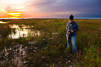 A photographer takes photos at dawn in Newport State Park, Door County, Wisconsin.