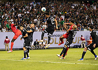 CHICAGO, IL - JULY 7: Jesus Gallardo #23 heads the ball away from the goal during a game between Mexico and USMNT at Soldier Field on July 7, 2019 in Chicago, Illinois.