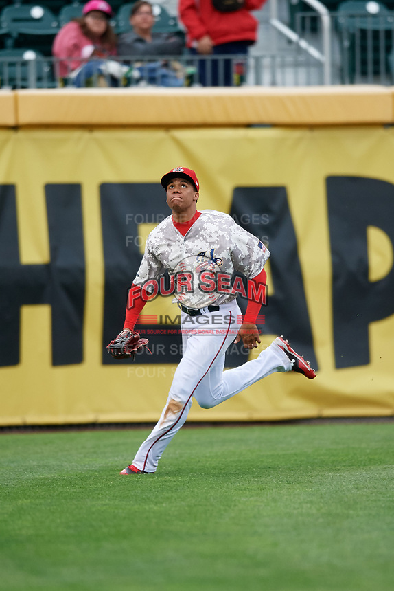 Harrisburg Senators left fielder Juan Soto (10) tracks a fly ball during the second game of a doubleheader against the New Hampshire Fisher Cats on May 13, 2018 at FNB Field in Harrisburg, Pennsylvania.  Harrisburg defeated New Hampshire 2-1.  (Mike Janes/Four Seam Images)