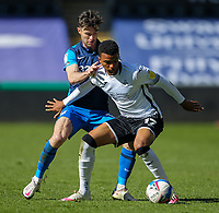 5th April 2021; Liberty Stadium, Swansea, Glamorgan, Wales; English Football League Championship Football, Swansea City versus Preston North End; Morgan Whittaker of Swansea City controls the ball while under pressure from Andrew Hughes of Preston North End