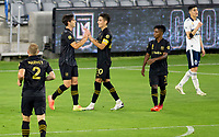 LOS ANGELES, CA - SEPTEMBER 23: Eduard Atuesta #20 of the Los Angeles football club celebrates a goal with team mate Francisco Ginella #8 during a game between Vancouver Whitecaps and Los Angeles FC at Banc of California Stadium on September 23, 2020 in Los Angeles, California.