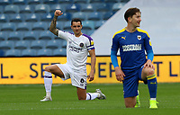 Oliver Norburn of Shrewsbury Town raises his fist and kneels before the match begins during AFC Wimbledon vs Shrewsbury Town, Sky Bet EFL League 1 Football at The Kiyan Prince Foundation Stadium on 17th October 2020