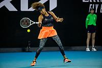 10th February 2021, Melbourne, Victoria, Australia; Naomi Osaka of Japan returns the ball during round 2 of the 2021 Australian Open on February 10 2020, at Melbourne Park in Melbourne, Australia.