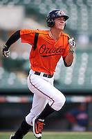 GCL Orioles right fielder Tristan Graham (24) runs to first base during a game against the GCL Red Sox on August 16, 2016 at the Ed Smith Stadium in Sarasota, Florida.  GCL Red Sox defeated GCL Orioles 2-0.  (Mike Janes/Four Seam Images)