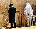 Two men praying at the Western Wall by the Temple Mount in Jerusalem, Israel