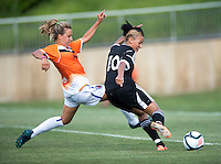 Lianne Sanderson (10) of the D.C. United Women shoots past Shelly Lyle (88) of the Charlotte Lady Eagles during the game at the Maryland SoccerPlex in Boyds, Maryland.  The D.C. United Women defeated the Charlotte Lady Eagles, 3-0, to win the W-League Eastern Conference Championship.