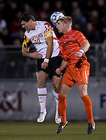 Jake Pace (20) of Maryland goes up for a header with Kyle Fisher (2) of Clemson during the ACC tournament semifinals at the Maryland SoccerPlex in Boyds, MD.  Maryland defeated Clemson, 1-0, in overtime.