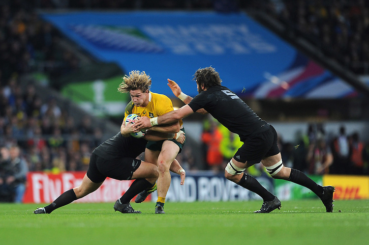 Michael Hooper of Australia is tackled by Joe Moody and Samuel Whitelock of New Zealand during the Rugby World Cup Final between New Zealand and Australia - 31/10/2015 - Twickenham Stadium, London<br /> Mandatory Credit: Rob Munro/Stewart Communications