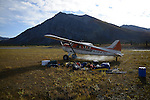 A Coyote Air bush plane, piloted by owner Dirk Nickisch, takes off after taking a group and their gear to the Sheenjek River valley, which flows south from Alaska's Brooks Range into the Yukon River Flats, in the Arctic National Wildlife Refuge in late August.