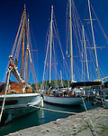 Antigua, West Indies<br /> Wooden sail boats moored at the English Harbor wharf,<br /> Nelson's Dockyard National Park