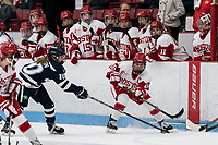 BOSTON, MA - FEBRUARY 16: Lauren Martin #10 of University of New Hampshire and Sammy Davis #16 of Boston University battle for the puck during a game between University of New Hampshire and Boston University at Walter Brown Arena on February 16, 2020 in Boston, Massachusetts.
