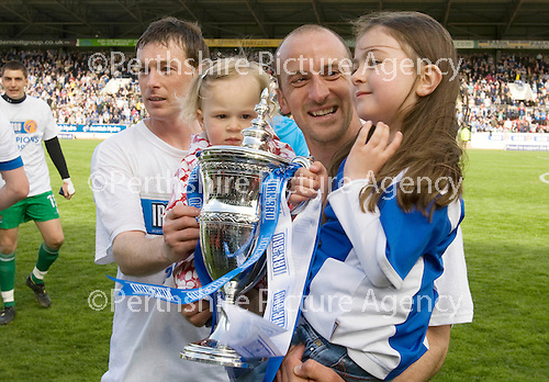 St Johnstone v Morton....02.05.09.Stuart McCaffrey joins Paul Sheerin and his daughters Dervla and Orla with the first division trophy.Picture by Graeme Hart..Copyright Perthshire Picture Agency.Tel: 01738 623350  Mobile: 07990 594431