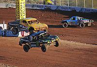 Dec. 10, 2011; Chandler, AZ, USA;  LOORRS pro 2 unlimited driver Jeremy McGrath (2) and Rob Naughton (54) during round 15 at Firebird International Raceway. Mandatory Credit: Mark J. Rebilas-