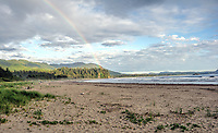 A rainbow shows at dusk on Hobuck Beach, Makah Indian Reservation, WA.