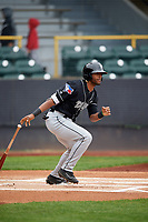 Lansing Lugnuts center fielder Joshua Palacios (2) follows through on a swing during a game against the Clinton LumberKings on May 9, 2017 at Ashford University Field in Clinton, Iowa.  Lansing defeated Clinton 11-6.  (Mike Janes/Four Seam Images)