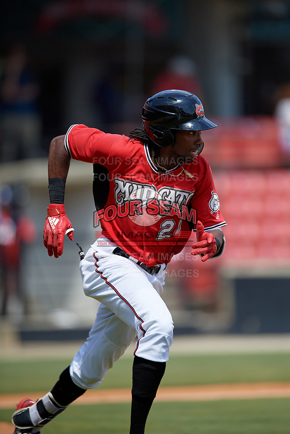 Carolina Mudcats Wes Rogers (24) runs to first base during a Carolina League game against the Winston-Salem Dash on August 14, 2019 at Five County Stadium in Zebulon, North Carolina.  Winston-Salem defeated Carolina 4-2.  (Mike Janes/Four Seam Images)