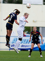 USWNT captain (3) Christie Rampone goes up for a header against Iceland's (9) Margret Vidarsdottir during the Algarve Cup.  The USWNT defeated Iceland, 1-0, at Ferreiras, Portugal.