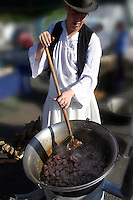 Youn man wearing traditional costume of Bugac Pusza and cooking - Hungarian Regional Gastronomic Festival 2009 - Gyor ( Gy?r ) Hungary