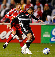 Chicago Fire midfielder Chris Armas (14) tries to slow up DC United midfielder Fred (7). The Chicago Fire defeated D. C. United 1-0 during the first leg of the MLS Eastern Conference Semifinal Series at Toyota Park in Bridgeview, IL, on October 25, 2007.