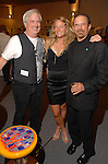 Wade Wilson, Naomi Barker and Marshal Lightman at the Red Bull Art of Can exhibit opening party at The Galleria Friday July 11,2008.