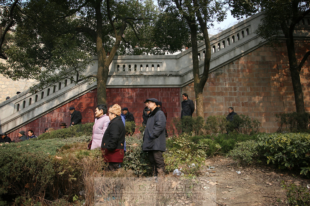 CHINA. Hubei Province. Wuhan. Elderly people gather in a park for morning activities.  Wuhan (population 4.3 million) is a sprawling city that sits on both sides of the Yangtze River.  2008