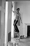 Patrick Procktor artist London 1969. PP decorating his Manchester Street flat, helping him is fellow artist and friend Mo McDermott,who is out of shot. 1968 1999