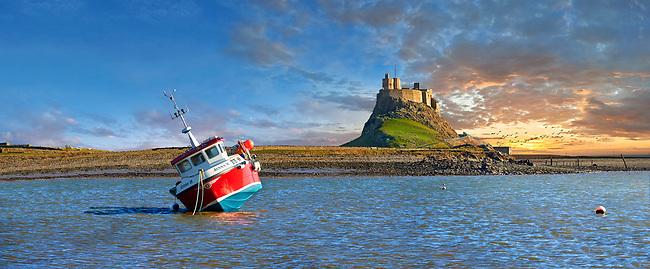 Lindisfarne Castle &  fishing boat ar sunset- 16th Century castle, Holy Island, Lindisfarne, Northumberland, England