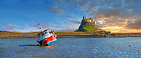 Lindisfarne Castle &  fishing boat ar sunset- 16th Century castle, Holy Island, Lindisfarne, Northumberland, England